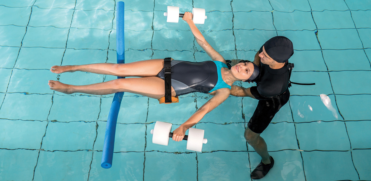 Injured woman doing hydrotherapy
